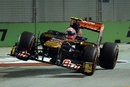 Jaime Alguersuari launches his Toro Rosso over the kerbs at turn 10
