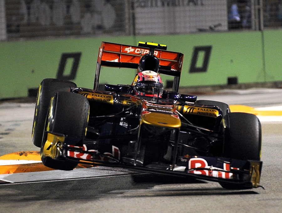 Jaime Alguersuari lands his Toro Rosso after clobbering the kerbs