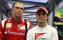 Felipe Massa and Stefano Domenicali looking unimpressed in the Ferrari garage