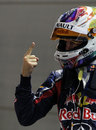 Sebastian Vettel celebrates taking pole position in his customary style