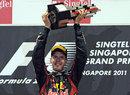 Sebastian Vettel raises his trophy on the podium