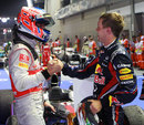 Jenson Button congratulates Sebastian Vettel after the race