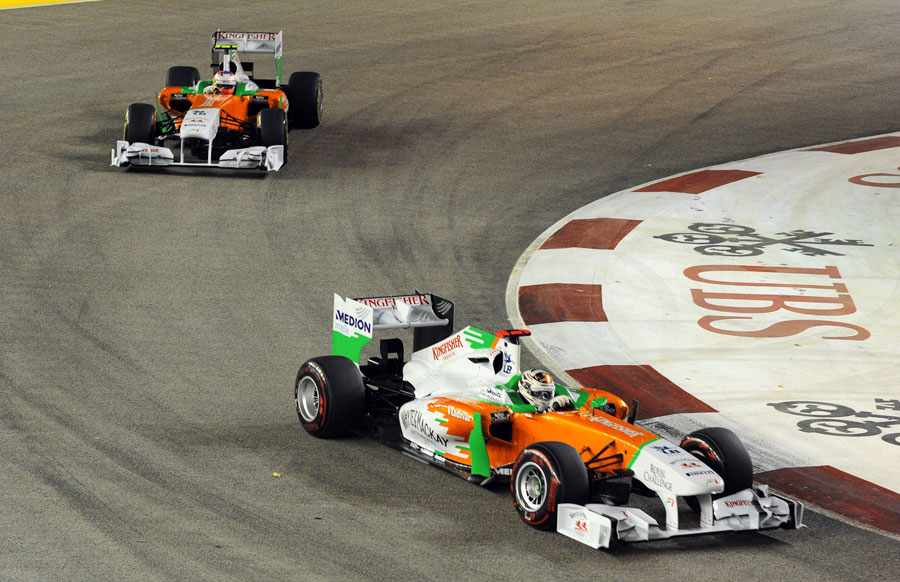 Adrian Sutil leads his Force India team-mate Paul di Resta