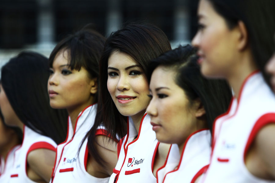 Grid girls ahead of the race