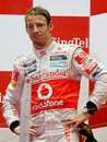 Jenson Button cuts a drained figure on the podium