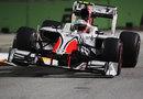 Vitantonio Liuzzi crashes over the kerbs on a qualifying lap