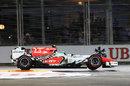 Vitantonio Liuzzi flies over the kerbs on a qualifying lap