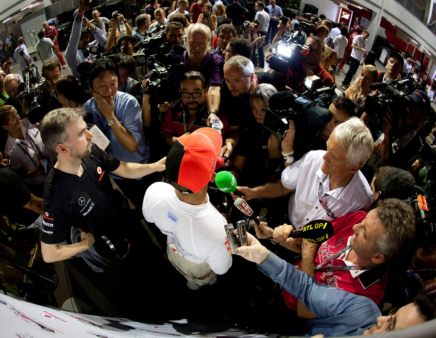 Lewis Hamilton faces the media scrum after the Singapore Grand Prix