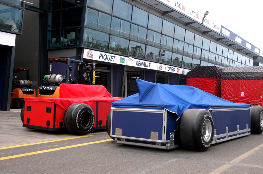 Freight is unloaded in the pit lane