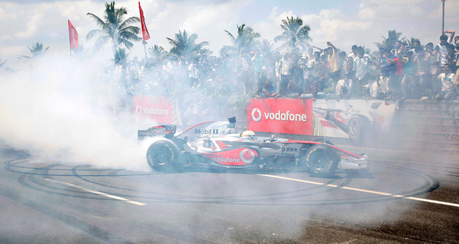 Lewis Hamilton performs on the Bangalore-Mysore highway during a promotional event