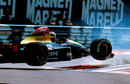 Aguri Suzuki launches his Larrousse backwards over the first chicane