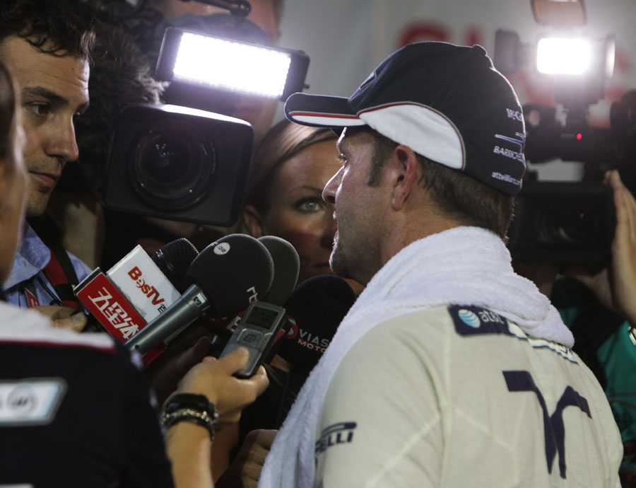 Rubens Barrichello faces the world's press