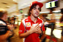Fernando Alonso sneaks out of the autograph signing session