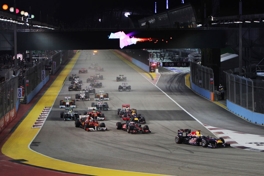 Sebastian Vettel leads the field in to turn one