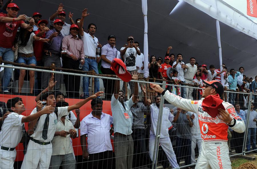 Lewis Hamilton throws McLaren goodies to fans in Bangalore