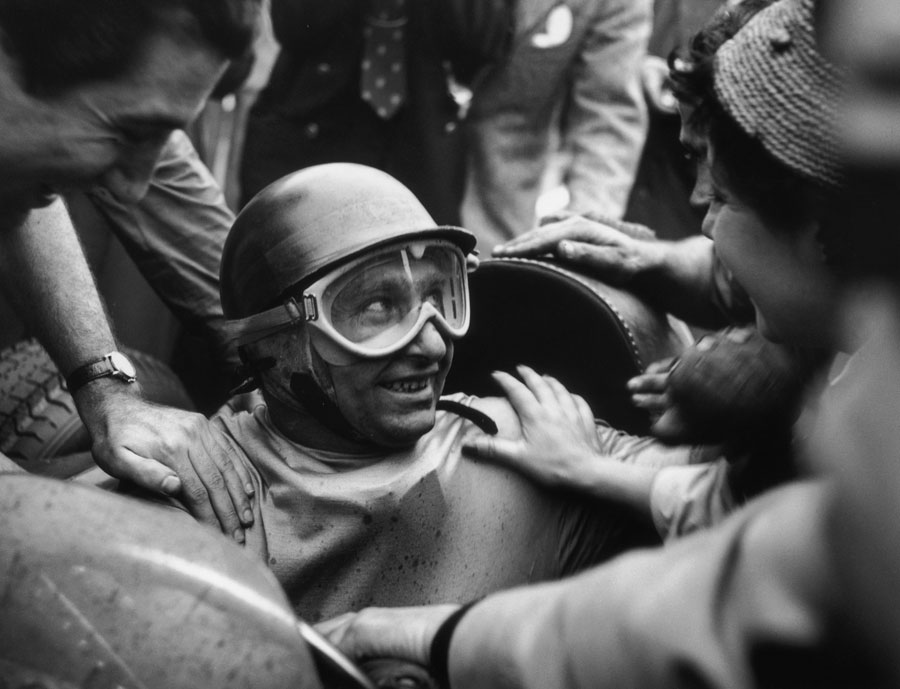 Juan Manuel Fangio returns to the paddock after victory