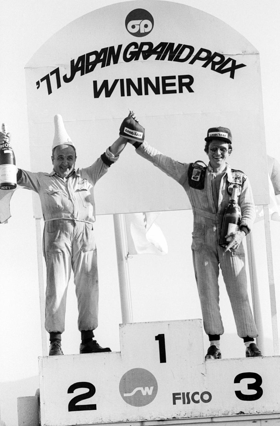 Patrick Depailler was the only driver to take to the podium and celebrates with the Marelli Magneti representative
