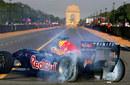 Daniel Ricciardo drives down the Rajpath in the Red Bull showcar