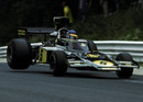 Ronnie Peterson rides the jump at Pflanzgarten on the Nurburgring