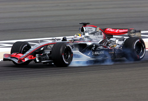 Juan Pablo Montoya locks a tyre in Bharain