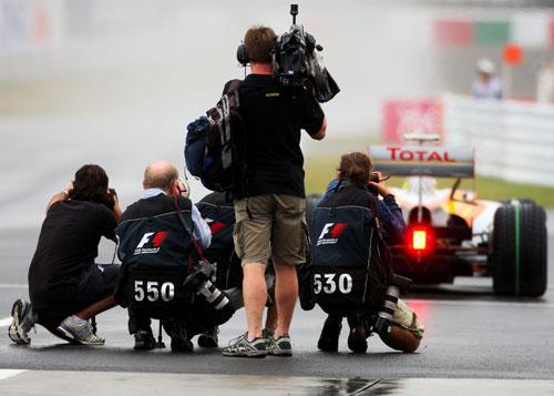 F1 photographers shoot Romain Grosjean leaving the pits