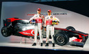Jenson Button and Lewis Hamilton stand in front of their new car