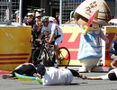 Jarno Trulli picks his way through an accident in the soapbox race on the pit straight