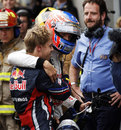 Sebastian Vettel congratulates Jenson Button on his win after spinning off on the last lap