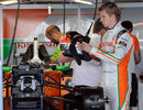 Nico Hulkenberg prepares his equipment in the Force India garage