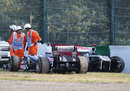 Rubens Barrichello's and Pastor Maldonado's stricken Williams' sit on the outside of the Degner curves