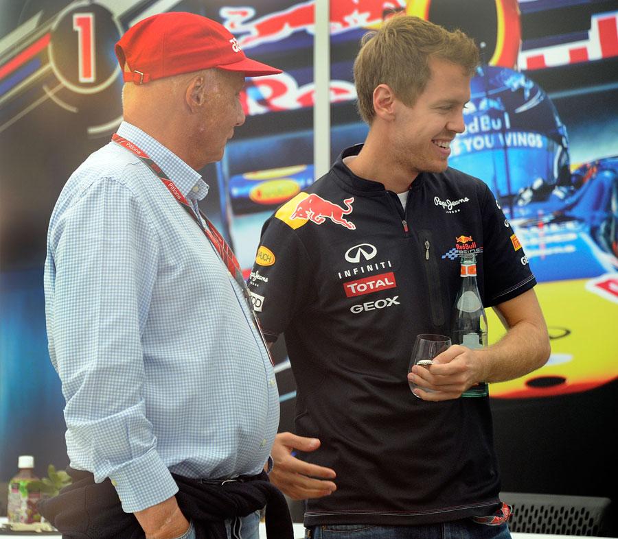 Sebastian Vettel and Niki Lauda chat in the Red Bull hospitality