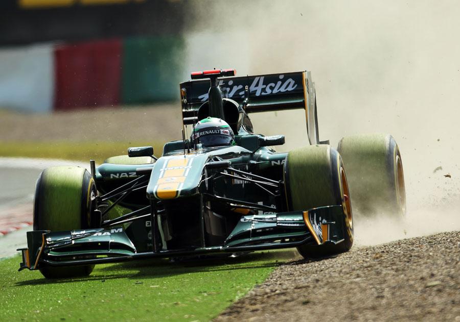 Heikki Kovalainen dips two wheels in the gravel