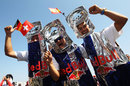 Red Bull fans dressed as Red Bull cans