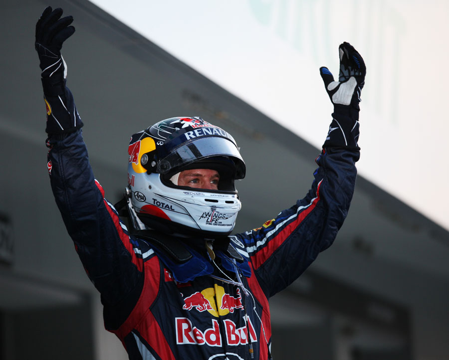Sebastian Vettel faces the crowd as a newly-crowned double world champion