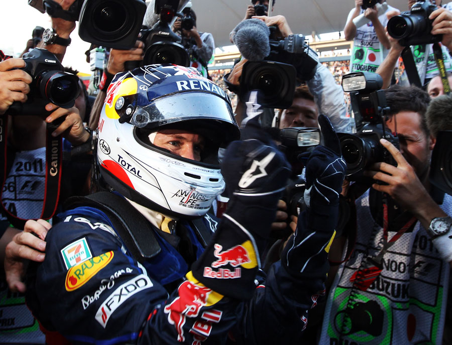 Sebastian Vettel celebrates his second world championship in a row in front of the cameras