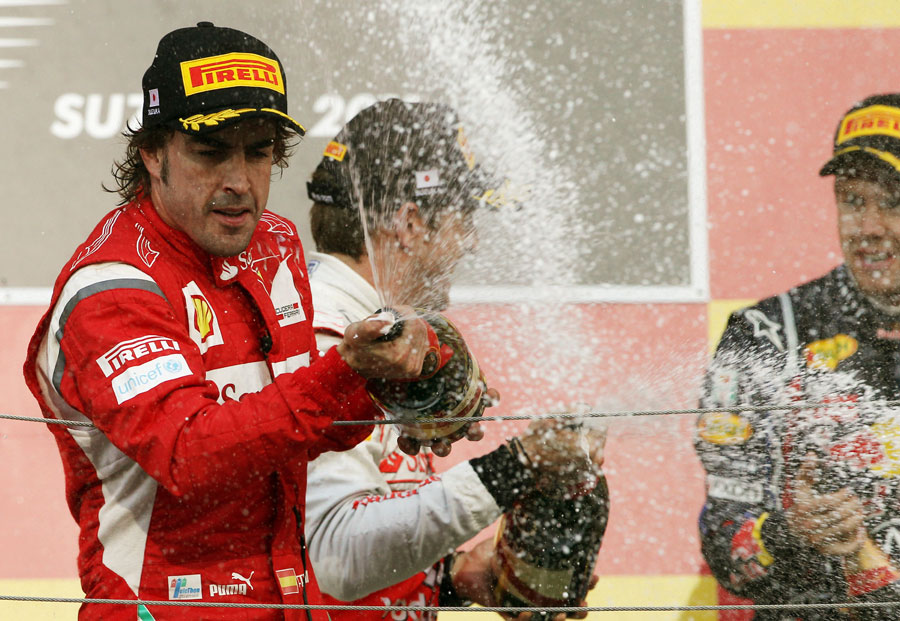 Fernando Alonso celebrates second place on the podium