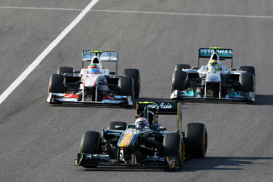 Nico Rosberg battles with Sergio Perez and Jarno Trulli