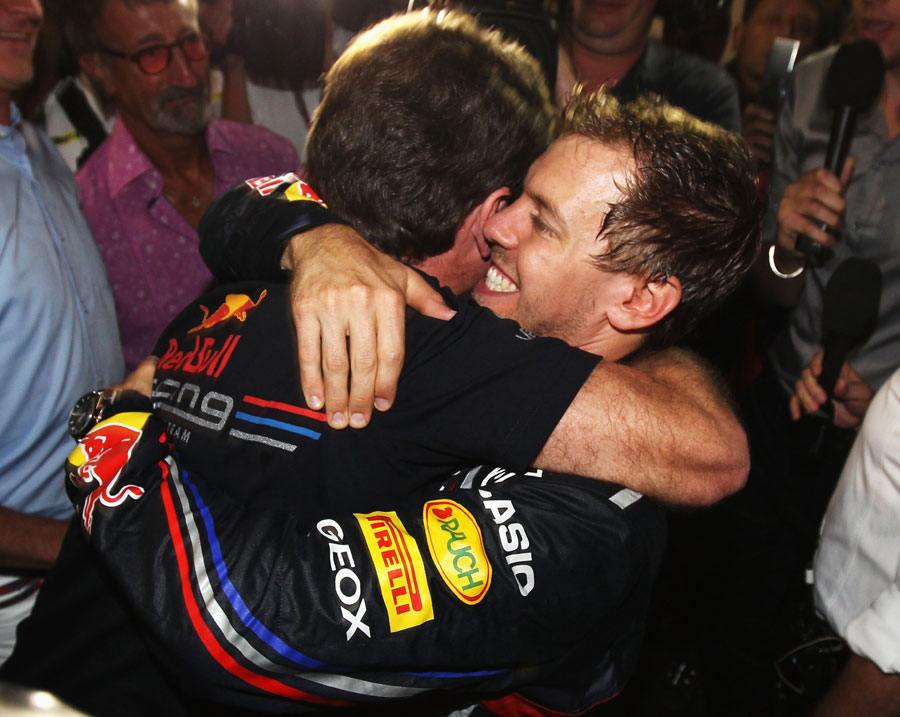 Christian Horner embraces Sebastian Vettel during a TV interview
