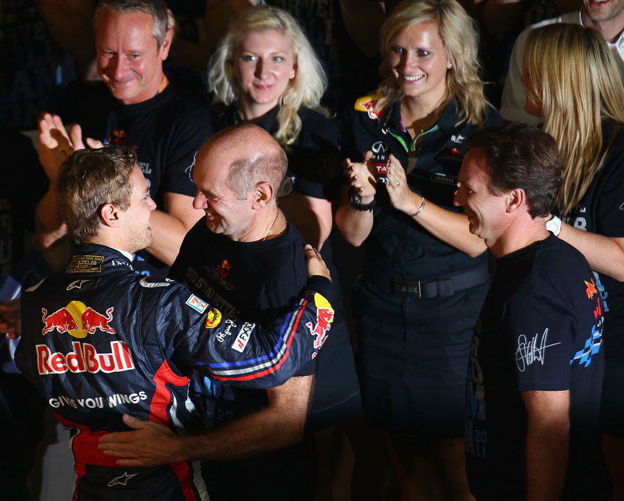 Sebastian Vettel celebrates his second world title with Adrian Newey