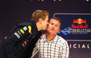 Sebastian Vettel gives David Coulthard a kiss during a Q&A session at Nissan HQ after winning his second world championship