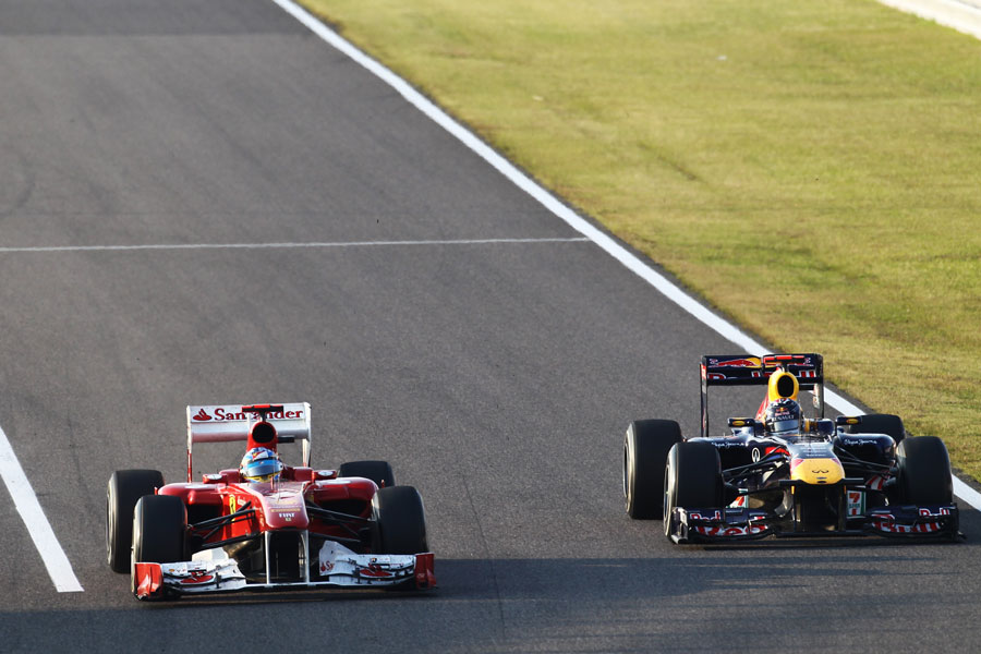 Fernando Alonso holds off Sebastian Vettel in to turn one