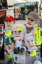 Bernie Ecclestone, Jenson Button, Michael Schumacher, Kamui Kobayashi and Takuma Sato hand puppets in the paddock