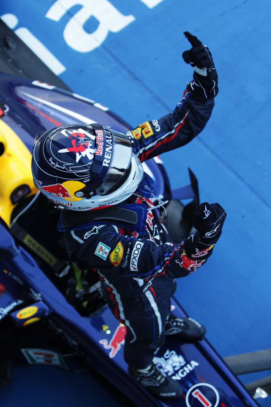 Sebastian Vettel celebrates his second world championship in parc ferme