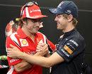 Fernando Alonso greets Sebastian Vettel