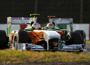 Paul di Resta leads Force India team-mate Adrian Sutil on track