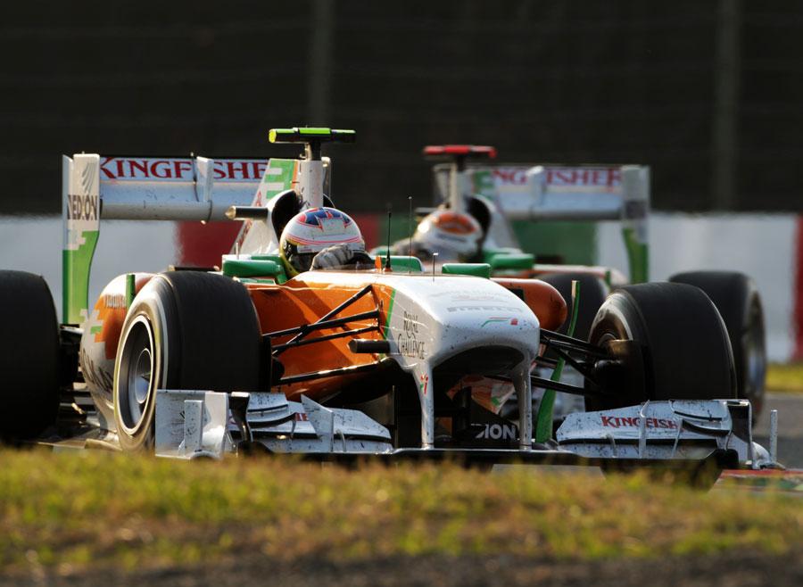 Paul di Resta leads Force India team-mate Adrian Sutil on track