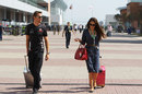 Jenson Button and his girlfriend Jessica Michibata arrive at the circuit
