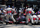 Jenson Button makes a pit stop for new tyres