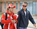 Felipe Massa and Michael Schumacher arrive at the circuit on Saturday morning