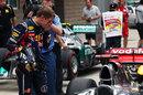 Sebastian Vettel inspects a McLaren in parc ferme